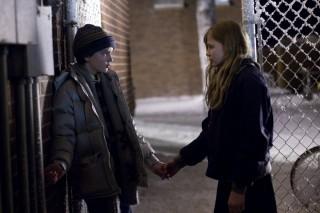Chloë Grace Moretz en Kodi Smit-McPhee in Let Me In