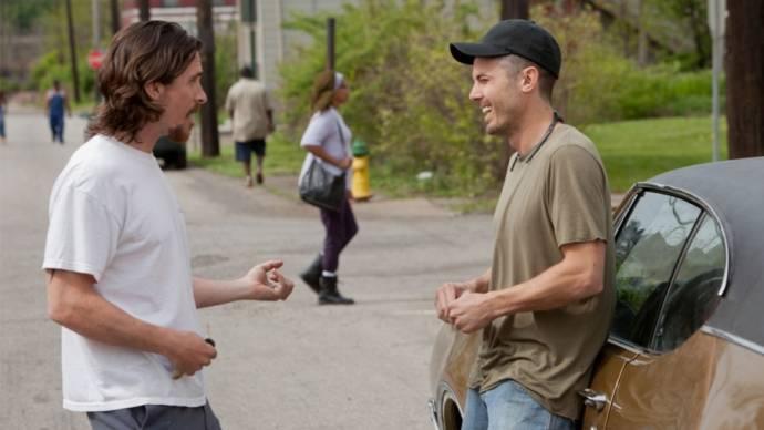 Christian Bale (Russell Baze) en Casey Affleck (Rodney Baze Jr.)