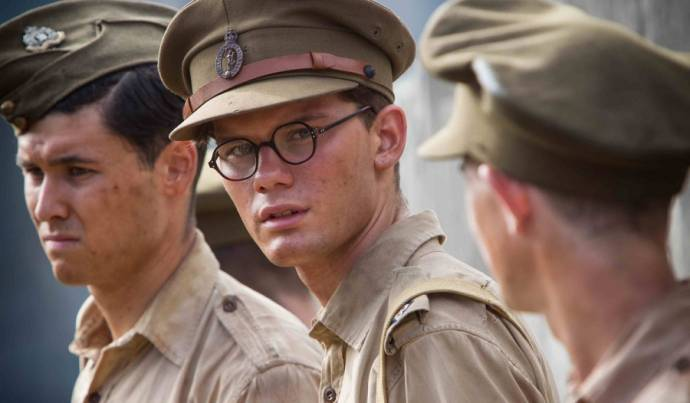 Jeremy Irvine (Young Eric Lomax)