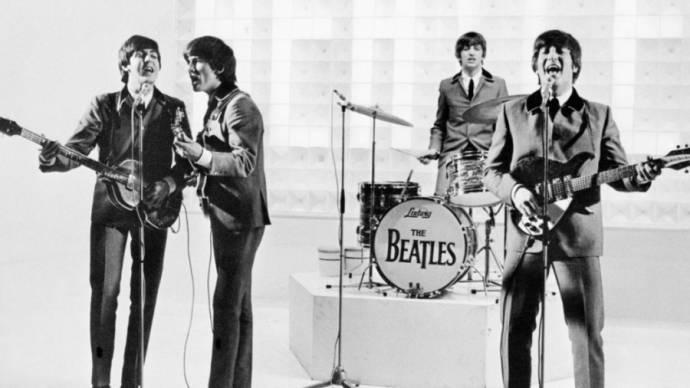 Paul McCartney (Paul), George Harrison (George), Ringo Starr (Ringo) en John Lennon (John)