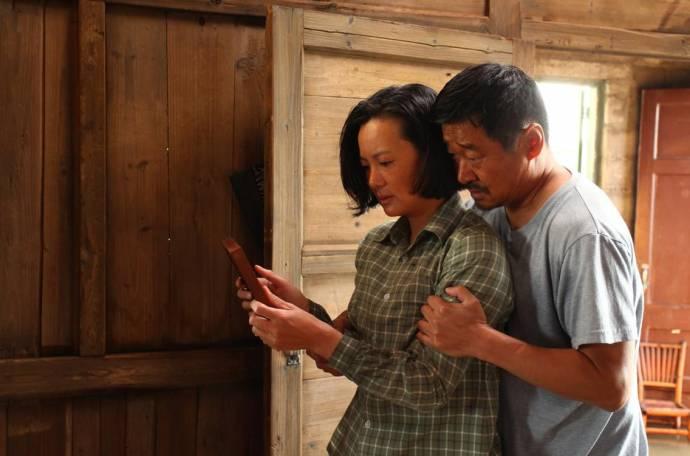 Mei Yong (Liyun Wang) en Wang Jinchun (Yaojun Liu)