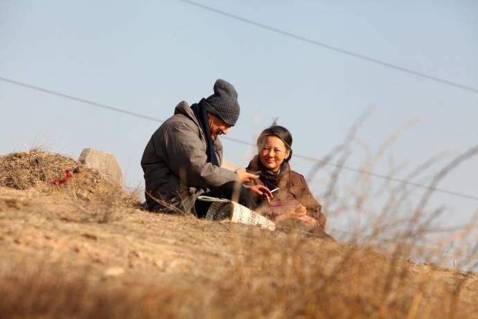 Wang Jinchun (Yaojun Liu) en Mei Yong (Liyun Wang)