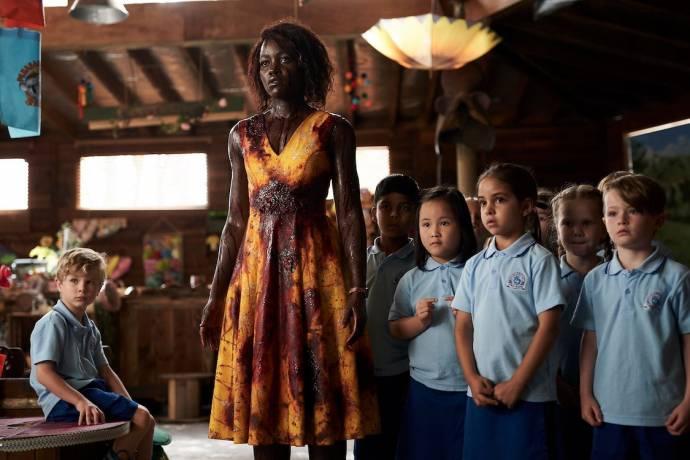 Lupita Nyong'o (Miss Caroline)