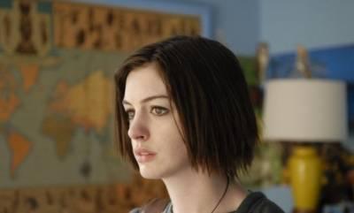Anne Hathaway (Kym)