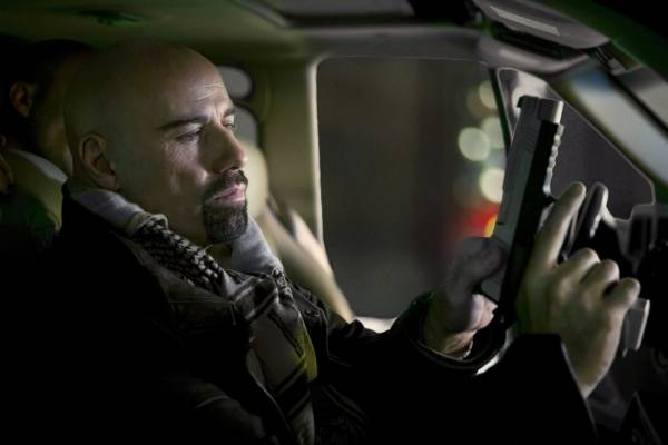 John Travolta (FBI agent Charlie Wax)