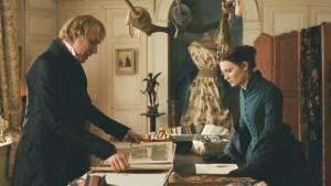 Madame Bovary: Rhys Ifans (Monsieur Lheureux) en Mia Wasikowska (Emma Bovary)