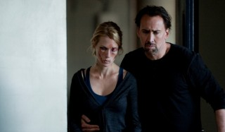 January Jones (I) en Nicolas Cage in Seeking Justice