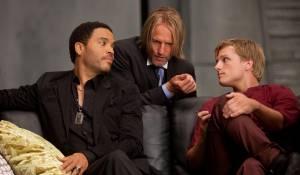 The Hunger Games: Lenny Kravitz (Cinna), Woody Harrelson (Haymitch Abernathy) en Liam Hemsworth (Gale Hawthorne)
